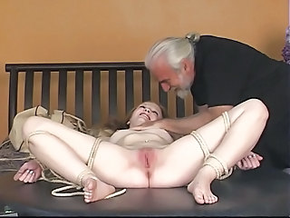Dude binds rosy-titted blonde'