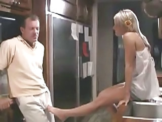 Girl giving a handjob to daddy