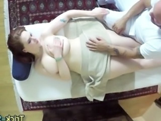 Massaged redhead lured into sucking a hot dick
