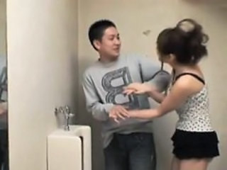 Yuma Asami gives good handjob at toilet
