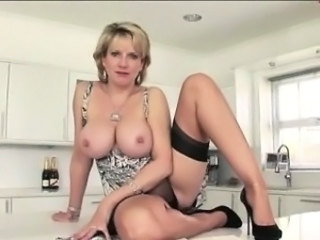 Mature british whore flashes tits