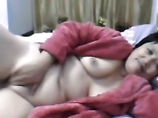 Video from: nuvid | Fat Chinese Granny In A Red Bathrobe On Webcam Skype