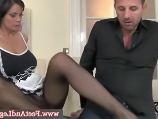Sheila Grant wanks him with her stockinged feet