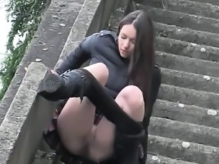 Two girlfriends pissing together on the stairs