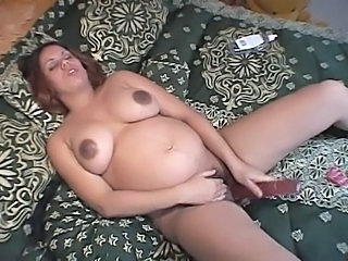 Pregnant Latina playing with some huge toys