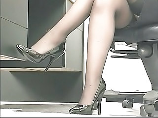 Young perky brunette coworker plays with a big toy at the office