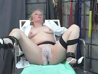 "Mad scientist pours hot wax on bound thick mature blonde's clit in dungeon"" class=""th-mov"