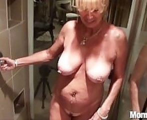 Busty cougar gets fucked in the shower