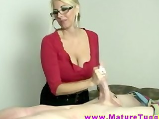 golden-haired mother i massages pecker with her hands