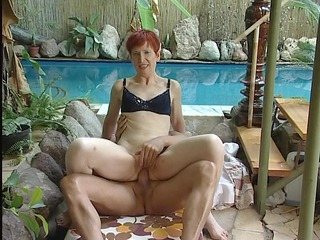 mature red-haired into bikini