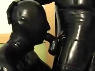 slave boy sucking cock in a latex blowjob hood