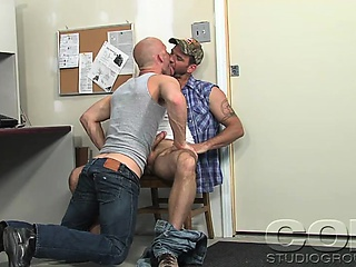 Hot stud and a truck driver makes hardcore sex in an office