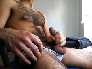 Hairy guy jacking off big cock
