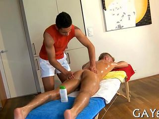 Oiled up guy gets his hot ass nailed during a massage