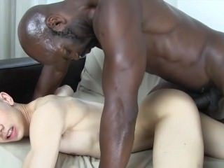 Black guy stuffing a boy