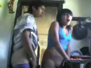 Video from: indiansex-xxx | Frantic fuck scene featuring a young Indian couple in the kitchen