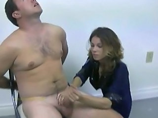 Policewoman tortures naked...