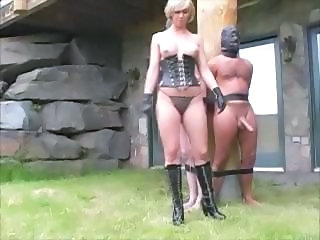 Nasty mistress ties-up her slaves to a pole and milks their dicks