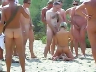 Amateur slut sucks dozen of cock on beach