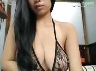 Busty asian babe stripping