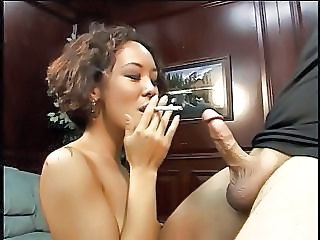 Short Haired Asian Sucks Cock While Puffing Cigarette