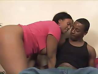 Chunky black babysitter sucks off a black thug's girthy dick then gets fucked