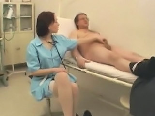 Female Doctor Examines A Cock