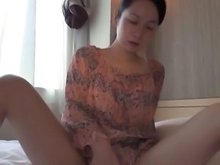 Asian whore toys pussy