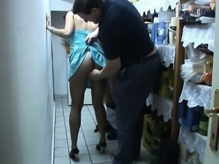 Romana jerks off two slaves in her cellar